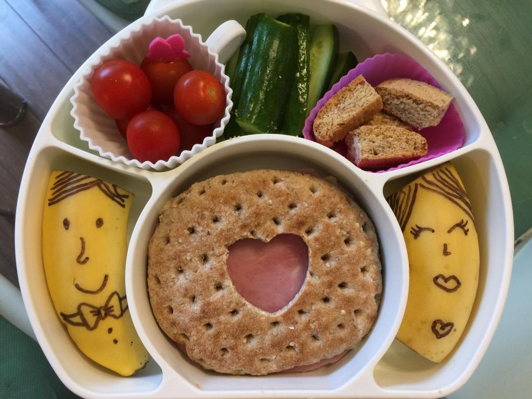 Whole-wheat flat bread ham & cheese sandwich, Persian cucumbers, Mr. & Mrs. banana, cherry tomatoes and biscotti for desert