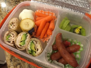 Big Sister Bento.  I prepared this bento for my elder daughter for school lunch. It includes Paleo turkey avocado wrap, Berkshire sausages, star-boiled egg, baby carrots, sliced kiwi and banana