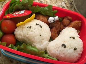 Bear rice balls (onigiri) filled with grilled salmon (left-over from dinner last night), Japanese fried chicken (Karaage), cherry tomatoes, and Hello Kitty Jello for desert